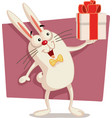 happy easter bunny holding gift box cartoon vector image