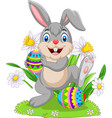 easter bunny with decorated eggs vector image vector image