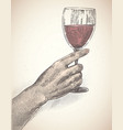 female hand holds a glass wine is made in vector image