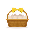 basket with yellow bow full fresh farm eggs vector image
