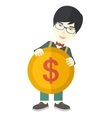 Asian Businessman holding a big coin vector image vector image