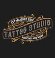 vintage tattoo logo with floral frame vector image vector image