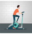 stationary bicycle young man is cycling on a vector image vector image
