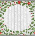 christmas wooden background with holly red berries vector image