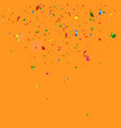 colorful confetti falling on orange background vector image vector image