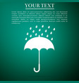 umbrella and rain drops icon on green background vector image vector image