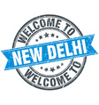 welcome to New Delhi blue round vintage stamp vector image vector image