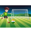An athlete kicking the ball with the flag of India vector image vector image