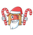 santa with candy mascot dog house of wood home vector image