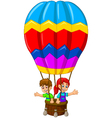 Funny two kids cartoon flying in a hot air balloon vector image