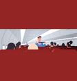 steward explaining passengers how to use seat belt vector image vector image