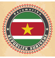 Vintage label cards of Suriname flag vector image vector image