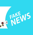 hand holding loudspeaker with text fake news on vector image vector image