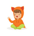 sweet smiling little girl dressed in fox sweater vector image vector image