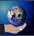 earth in hand elements of this furnished by nasa vector image vector image