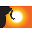 silhouette of man climbing in sunset background vector image