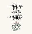 meet me under mistletoe calligraphy vector image