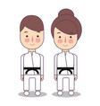 kids wearing karate uniforms black vector image