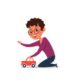 little boy playing with toy car flat