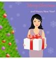 Girl with gift box near Christmas tree vector image vector image