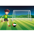 A male athlete kicking the ball with the flag of vector image vector image