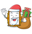 santa with gift picture frame mascot cartoon vector image