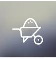 Wheelbarrow full of sand thin line icon vector image