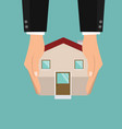 hands holding with house vector image vector image