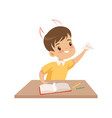 naughty boy ripping pages of book and doing paper vector image vector image