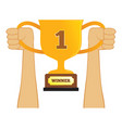 hand holding a winning trophy vector image