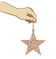 hand holding christmas star ornament vector image vector image