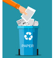 man hand throws garbage into a paper container vector image