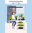 young woman taking care houseplants girl vector image vector image