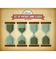 Set of vintage sand clocks on grungy card vector image