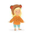cute little blonde girl dressed in a brown bear vector image vector image