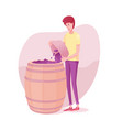 guy putting grapes to barrel vector image vector image