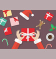 santa hand tied bow on gift box with vector image vector image