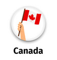 canada flag in hand round icon vector image