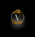 golden leaf letter v logo design with gold leafs