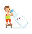 cute little boy and funny milk bottle with smiling vector image vector image