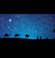 silhouette of caravan mit people and camels