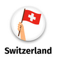 switzerland flag in hand vector image vector image