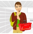 young man holding an empty shopping basket vector image vector image