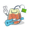 tea bag character cartoon art with guitar vector image vector image