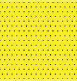 black polka dots on yellow background vector image
