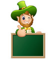 cartoon leprechaun giving thumbs up with chalkboar vector image