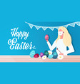 woman drawing on eggs happy easter spring holiday vector image