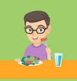 little caucasian boy eating vegetable salad vector image vector image