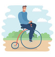 men riding a penny-farthing bicycle in a park vector image vector image