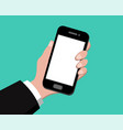 hand holding smart phone on green background vector image